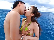 Mako Katase Sexy Asian gal is on a boat and kissing her boyfriend