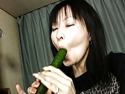 Japanese AV Model sucking long cucumber and fucks pussy with it