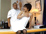 Japanese AV Model shyly disrobes for an examination by doctor