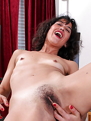 After a workout Anilos Penelope slides her fingers deep in her hairy milf pussy