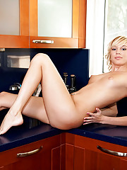 Petite Nubile washes her sensitive pussy in the kitchen sink