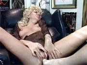 Rubbing her moist retro cooch with his foot