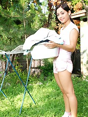 Teenager drying her moist clothes masturbates