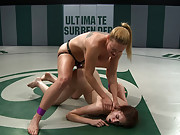 2 wrestlers with HUGE tits, battle in non-scripted wrestling. Blond destroys red head, makes her submit multiple times. Then fucks her like a whore.