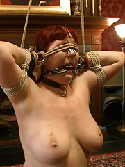 The Pope keeps her face distorted and smothered in leather, rope, and metal while they torture her beautiful breasts and sensitive pussy.
