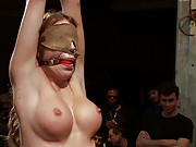 Amy Brooke is tied tight, manhandled, ass fisted, double penetrated and made to squirt for the amusement of the crowd.
