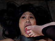 Bobbi Starr bolts dragonlily to the ground and uses her mouth to clean her dirty feet before shocking her cunt and making her cum