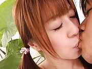 Mei Itoya Asian doll with sexy pigtails in hot kisses with man