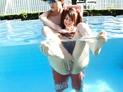 Hitomi Kitagawa has pussy caressed in the pool´s water by fellow