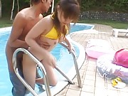 Yua Aida Asian sucking and getting long tool in peach at pool