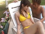 Yua Aida Asian in yellow bath suit has her nipples squeezed