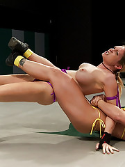 2 big titted blonds kick the shit out of each other in a brutal non-scripted wrestling. Nasty leg scissors, head locks & submissions, finger fucking.