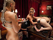 Hot dominatrix uses two slaves in chastity for her pleasure, milking one