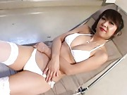 Maki Miyashita Asian shows tits in white bra and cunt in scanty