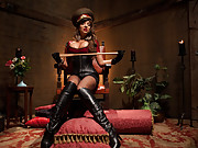 Strict eastern European dominatrix puts slaveboy through the ringer with boot worship, strap on ass fucking, OTK spanking and tease and denial.