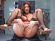 Japanese AV Model sits on medical table and rubs cunt with thong