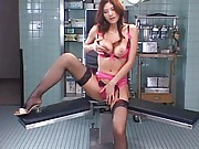 Japanese AV Model in pink lingerie and open legs plays with boobs