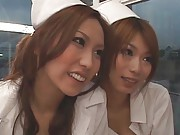 Hikari Hino nurse with black fishnet stockings is screwed in orgy