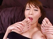Jessica Kisaki Asian licks two chaps toes and gets sperm on face