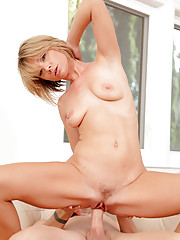Sensual cougar Holly Bryn rides a hard dick after giving head
