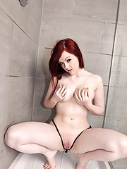 Adorable redhead loves showering her hot body