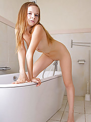 Teen Alla teases her wet pussy with the shower head in the bathtub