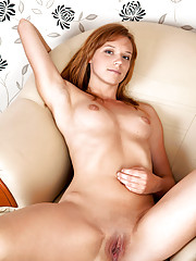 Hot freckle faced Nubile spreads her tight ass exposing her sweet pussy