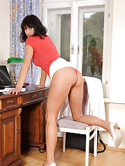Chelsea takes off her business suit and fucks a huge dong on her desk