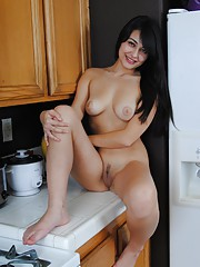 Sophia spreads her pussy on the countertops of her kitchen