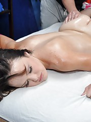 Shy brunette Izzi seduced and fucked hard on the massage table