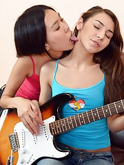 Guitar playing chick licks her friends pussy
