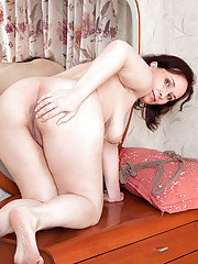 Thick granny stuffs with her landing strip pussy with a big dildo