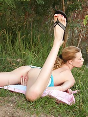 Gorgeous skinny teen pets herself outdoors