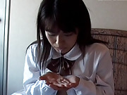 Cute asian schoolgirl gives head and spits