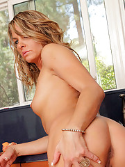 Blonde Anilos housewife spreads her pussy lips after a naughty striptease