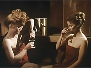 Two retro chicks enjoy massaging each other