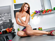 Pretty college girl masturbates atop the kitchen counter