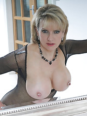 Fishnet catsuit mature dominatrix