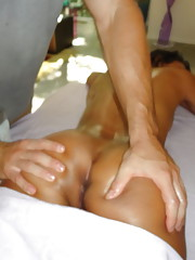 Horny slut gets pleasured on the massage table