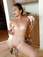 Classy Asian milf Lucky Starr fucks herself with a dildo on a chair