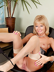 Secretary strips in the office and bends over exposing her pussy from behind