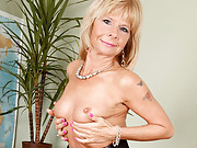 Sexy blonde cougar massages her natural breasts at Anilos