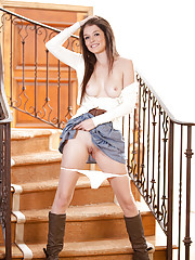 Tiffany Fox gets naked on the stairway and dips her finger deep in her moist juice box