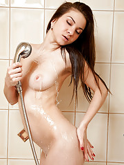 Naked Nubile Jillian sprays her pussy with a powerful stream of water