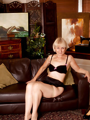 Elegant Anilos Penny pleasures her mature hairy pussy with her fingers