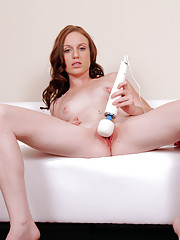 Daring temptress takes off her panties and pampers her pussy with a magic wand