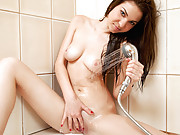 Curvy brunette fucks her soaking wet pussy with her toothbrush