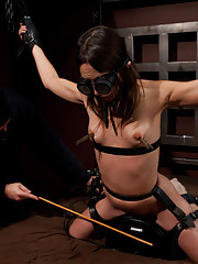 Amber Rayne is chained in a dark sanctum, and is made to cum against her will while being caned mercilessly by Sargeant Major.