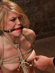 Hot blond from next door is bound in a sub basement. Her nipples abused, feet tickled and pussy fucked with a stick, made to cum like a whore.