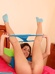 Horny Nubile bombshell pleasures her tight pussy with a blue sex toy